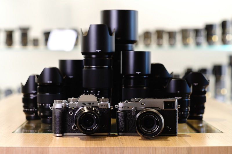 a couple of camera and a range of lenses