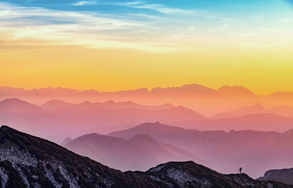 A colourful view of a mountain range