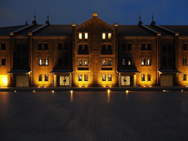 A mansion at night lit by yellow lights