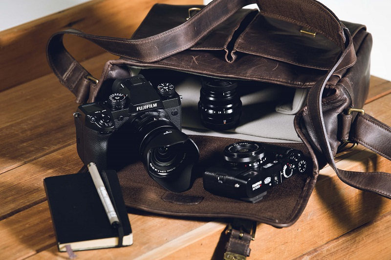 ona leather camera bag with fuji camera