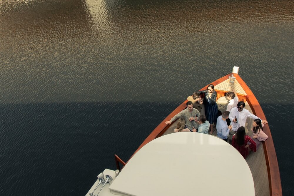 A group of people drinking during an event in a boat