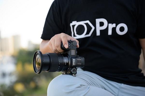 photographer holding dslr camera