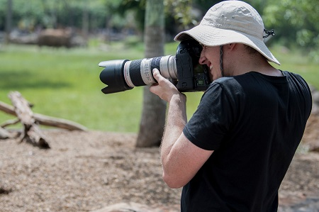 wildlife photographer taking photos in a zoo