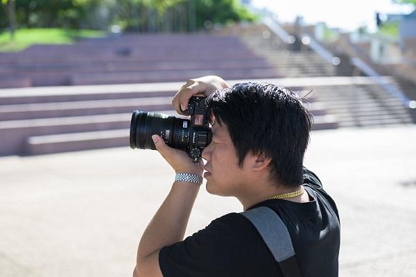 photographer using dslr with nikor z lens