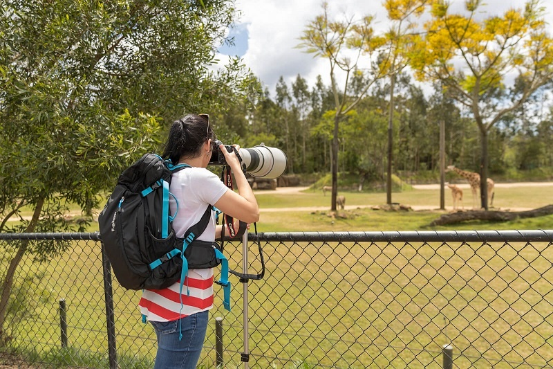 photographer with fstop backpack