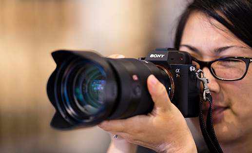 female photographer using a sony camera