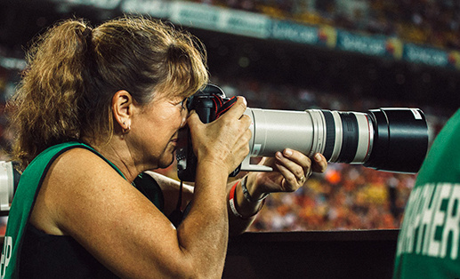 photographer using telephoto lens during a sports event