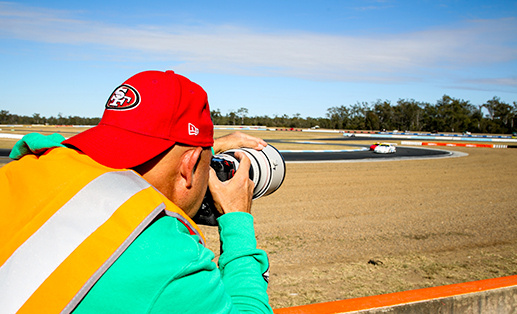 photographer covering a car race