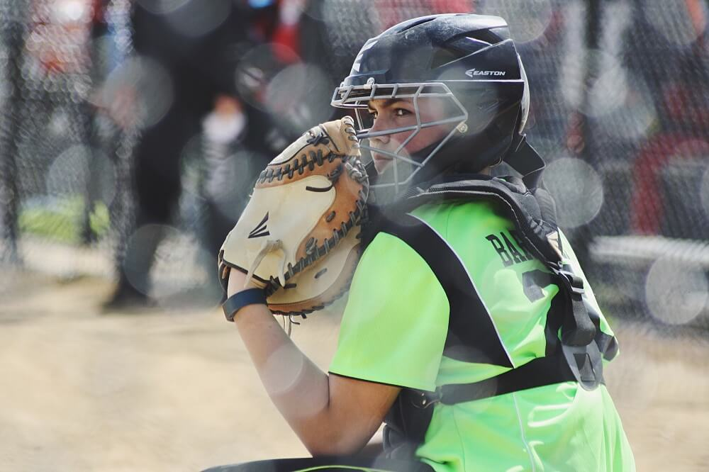 sports photography shot of a female baseball catcher