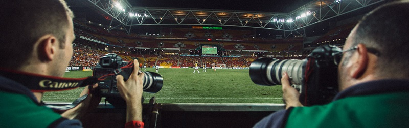 sports photographers covering a football match