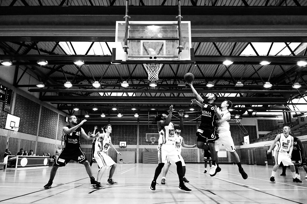 sports photography shot of basketball players in action