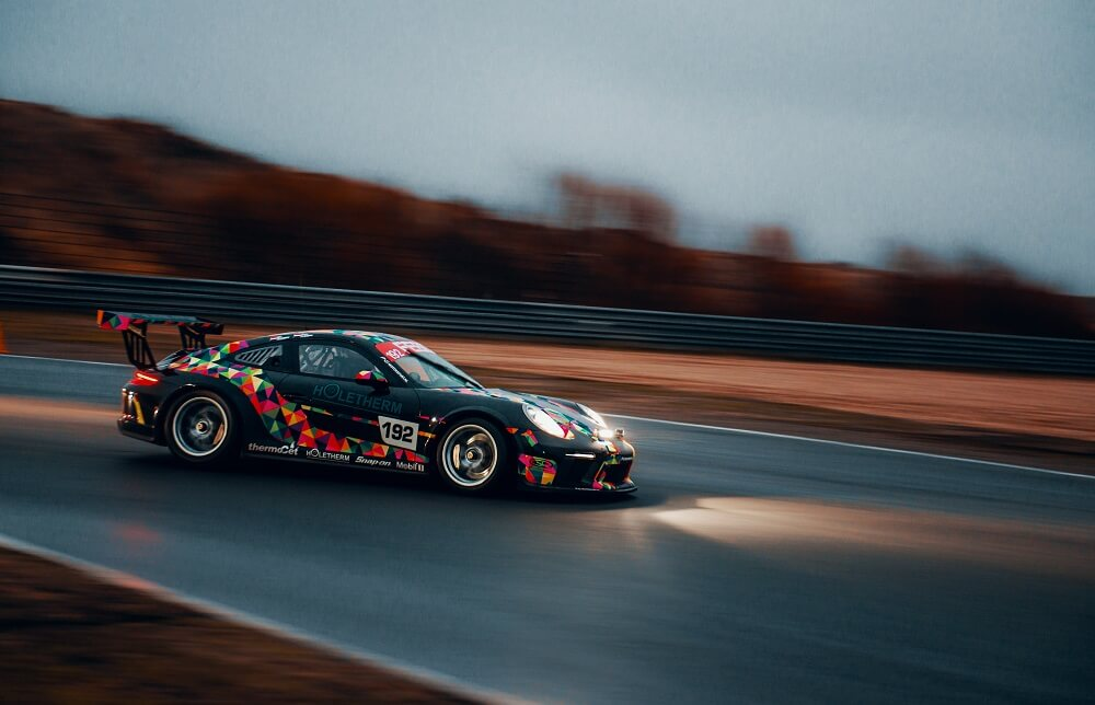 a sports photography shot of a race car