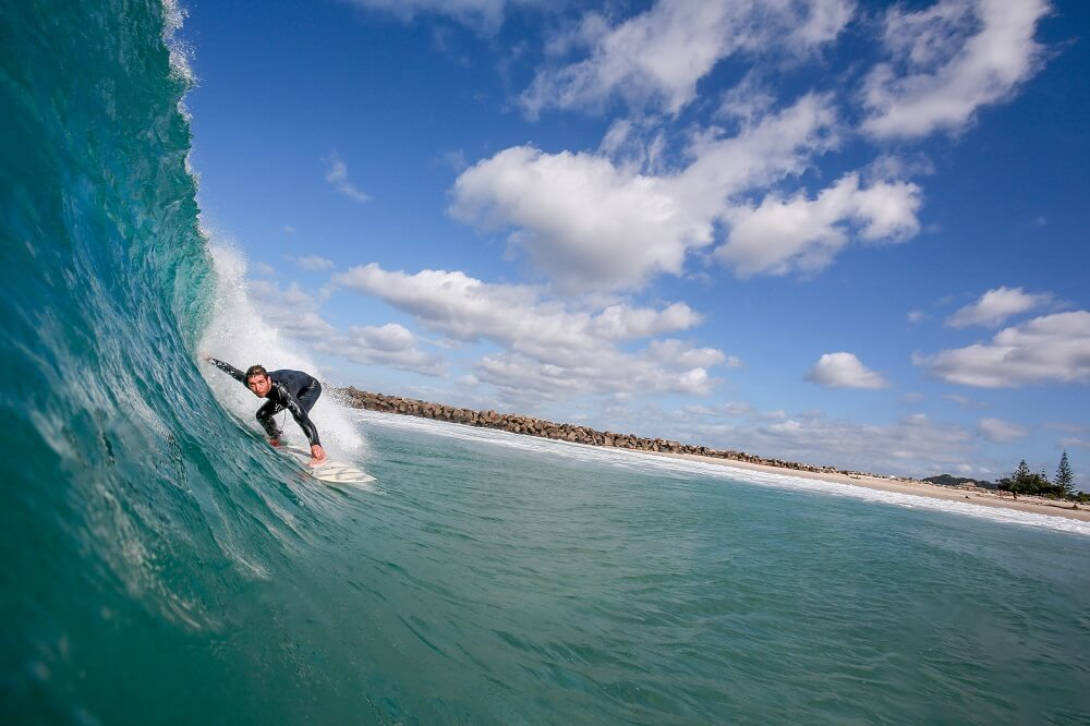 a sports photography shot of a surfer riding the waves