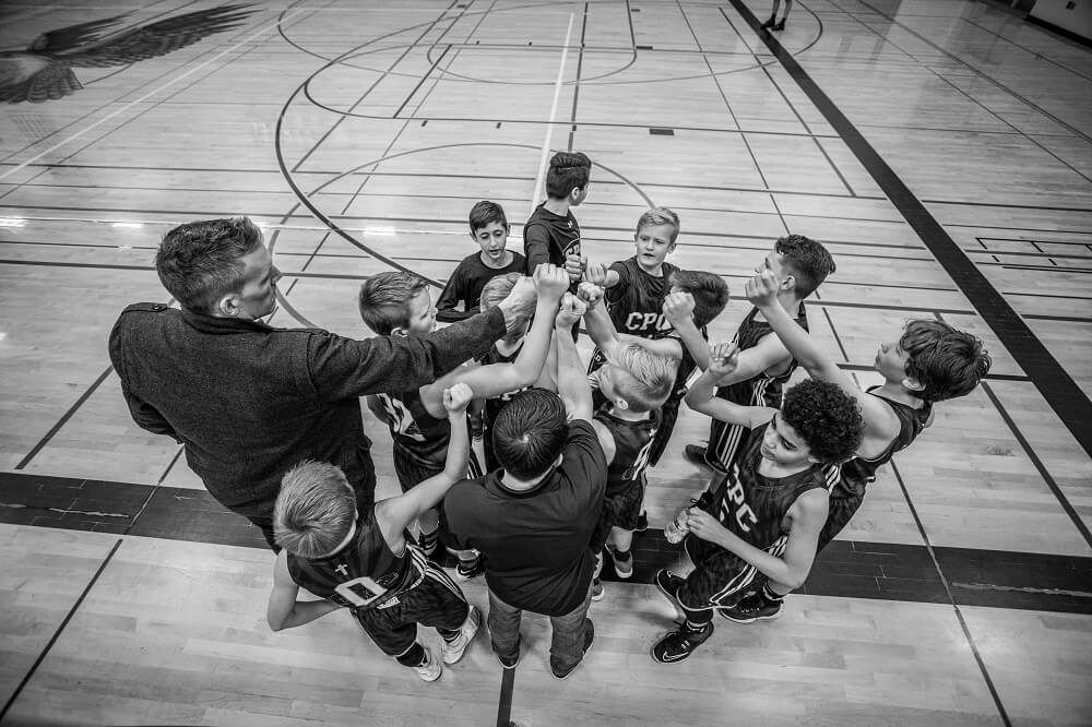 A sports photography shot of a team of young basketball players