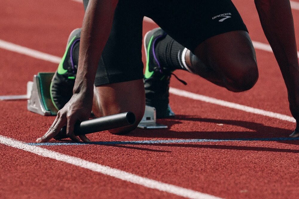 a sports photography shot of a runner's feet while on the starting lane
