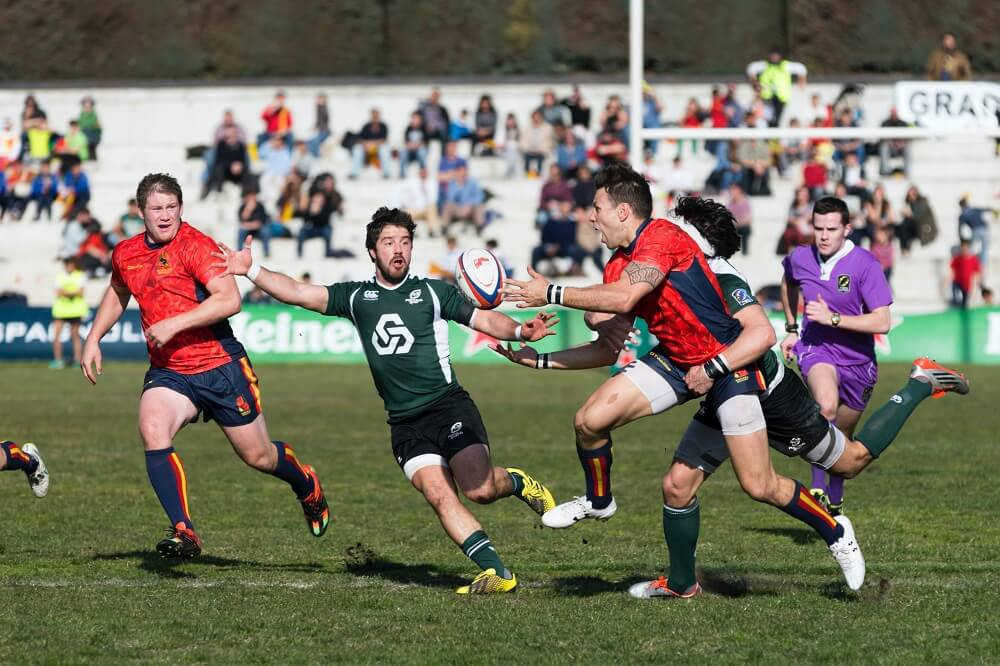 a sports photography shot of rugby players chasing the ball