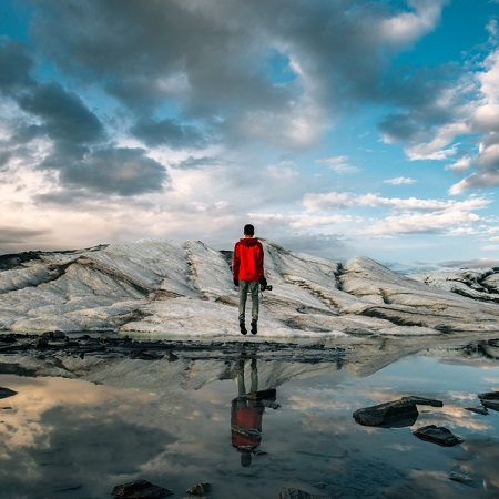 travel photography man in red windbreaker