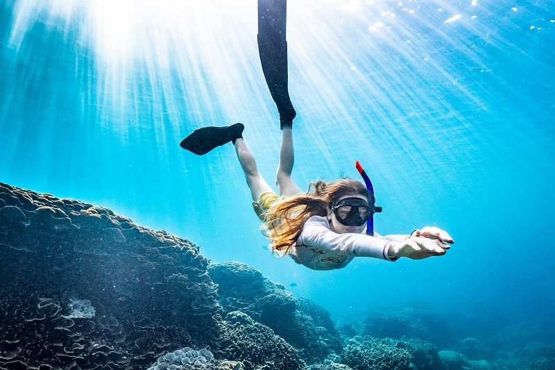 woman diving underwater in christmas island