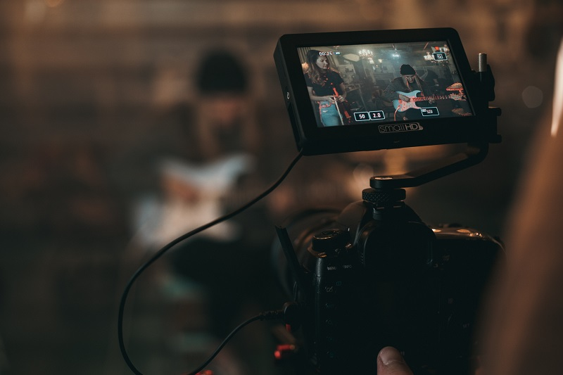 screen display of a video camera recording a band performance