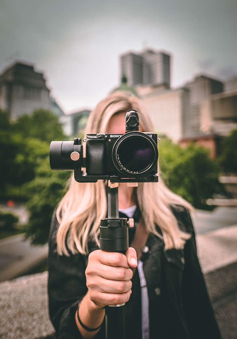 woman holding a camera with a gimbal