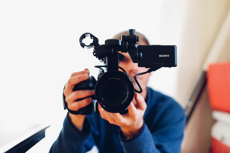 man holding a sony video camera