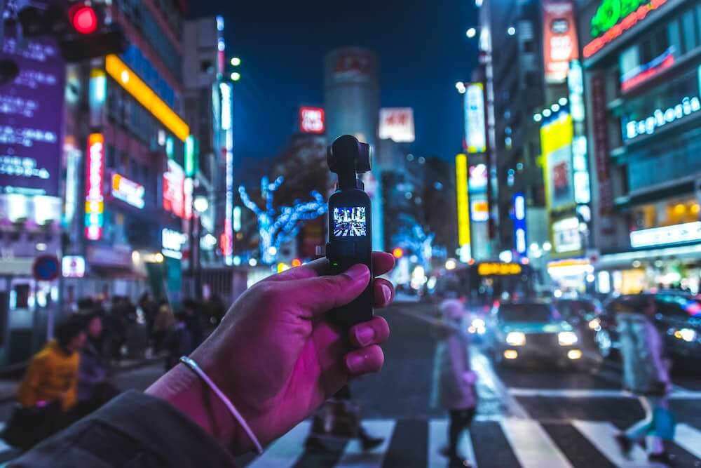 A guy in Japan holding a small vlogging camera