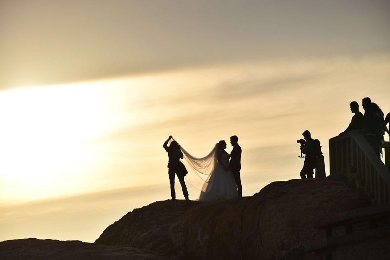 a silhouette of the bride, groom during a wedding photoshoot