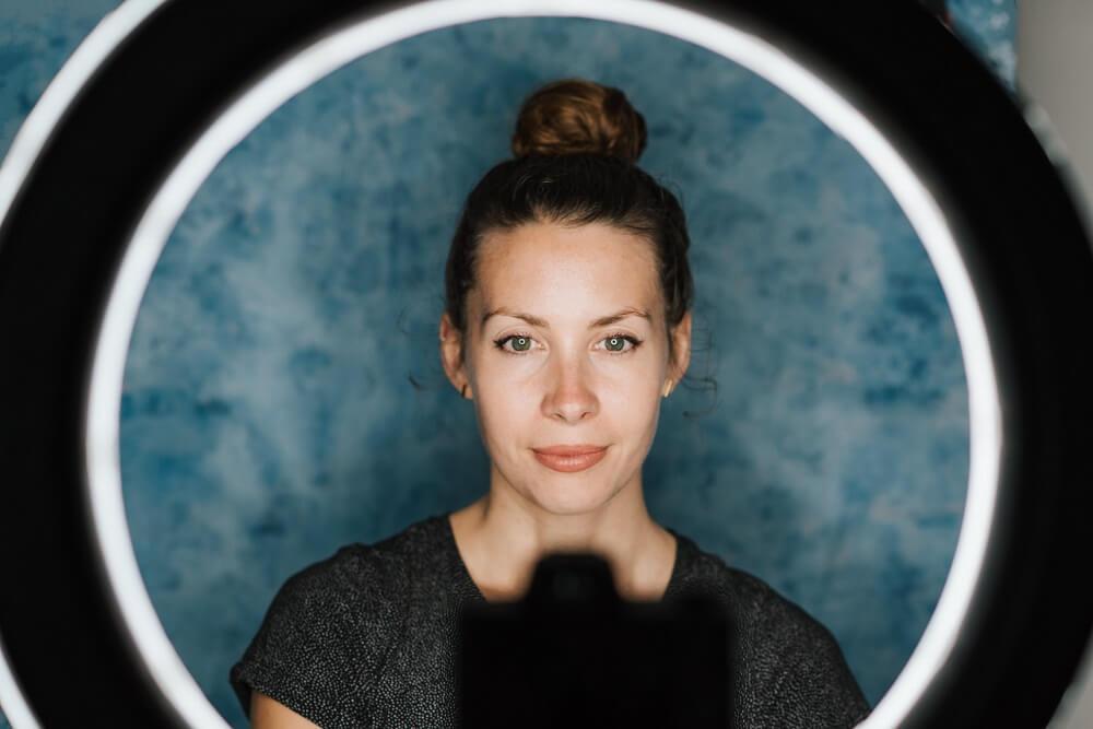 Female vlogger using a ring light setup