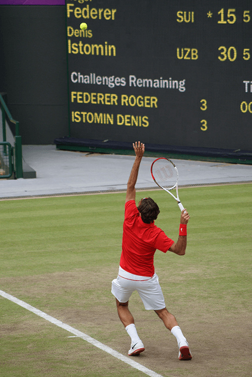tennis player in red serving