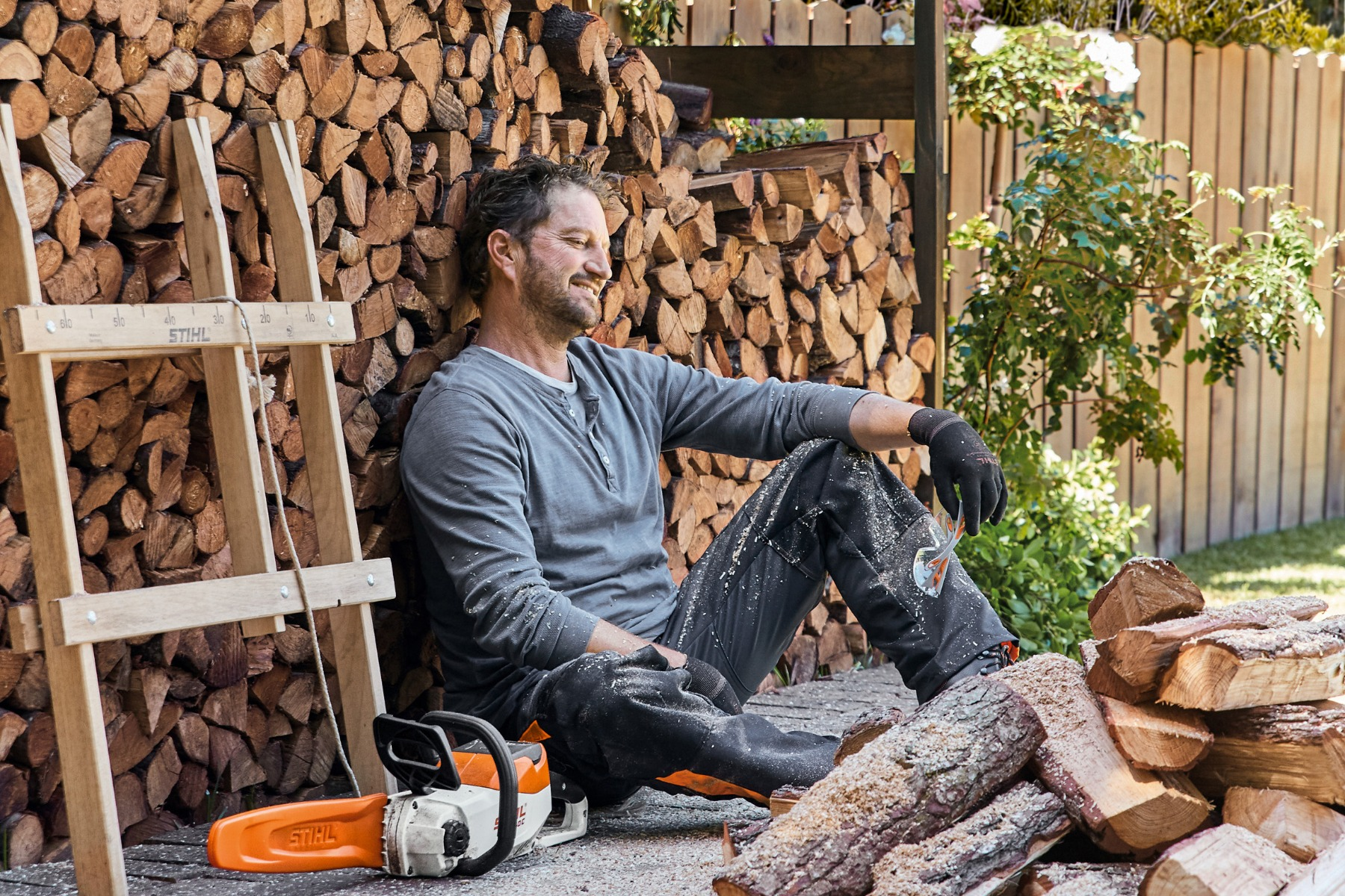 A man looking satisfied after cutting firewood with his STIHL Chainsaw