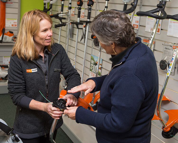 one of our friendly staffs sharing her expertise with a customer in a STIHL SHOP store