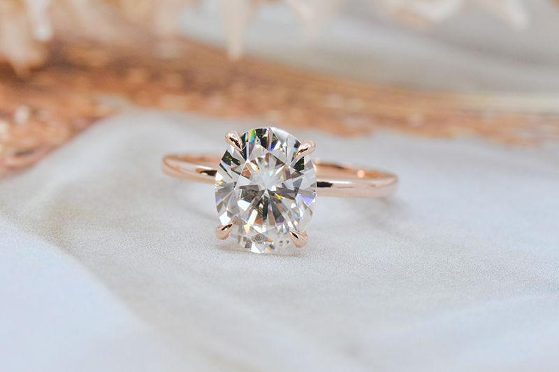 oval rose gold moissanite ring