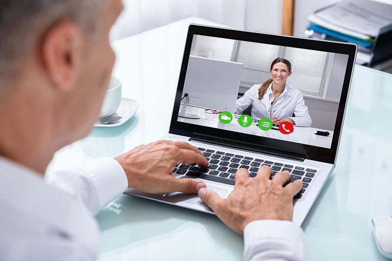 Doctor & Rep Having Facetime Conversation non-personal promotion