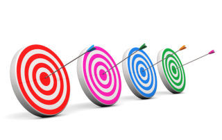 Arrows in bullseyes of four targets
