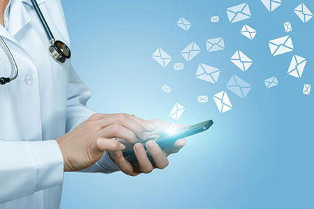 Doctor checking email on phone