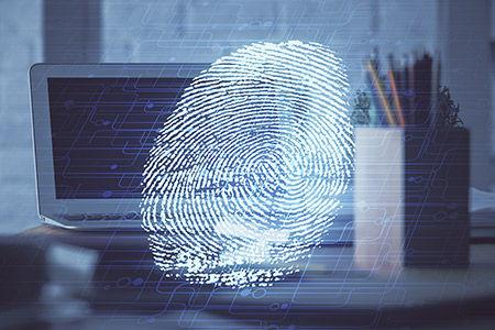 Fingerprint superimposed on computer