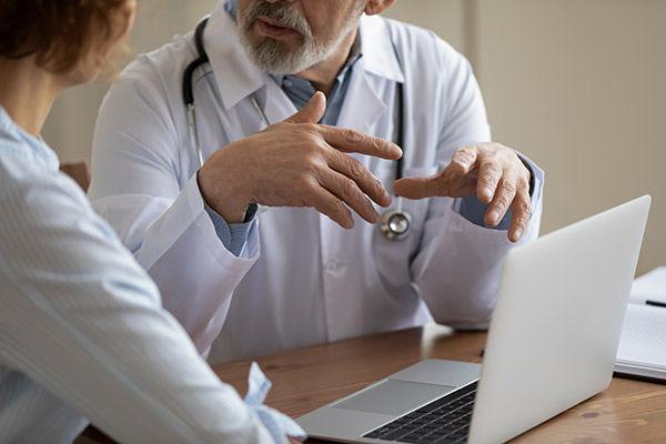 Doctor and patient having conversation