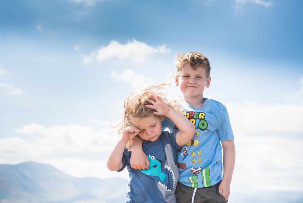 Boys on top of Binsey summitt, Lake District photographers