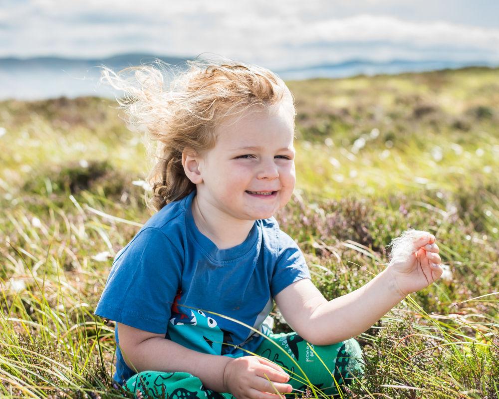 Albert holding fluffy grass, Lake District photographers