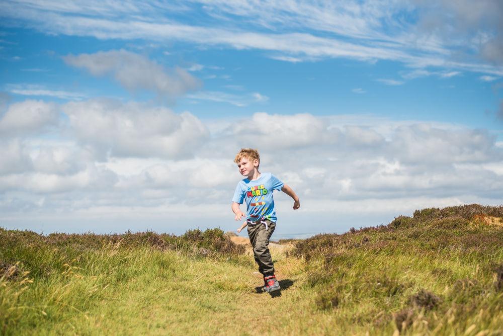 Stan running down hill, Binsey fell, Lake District photographers