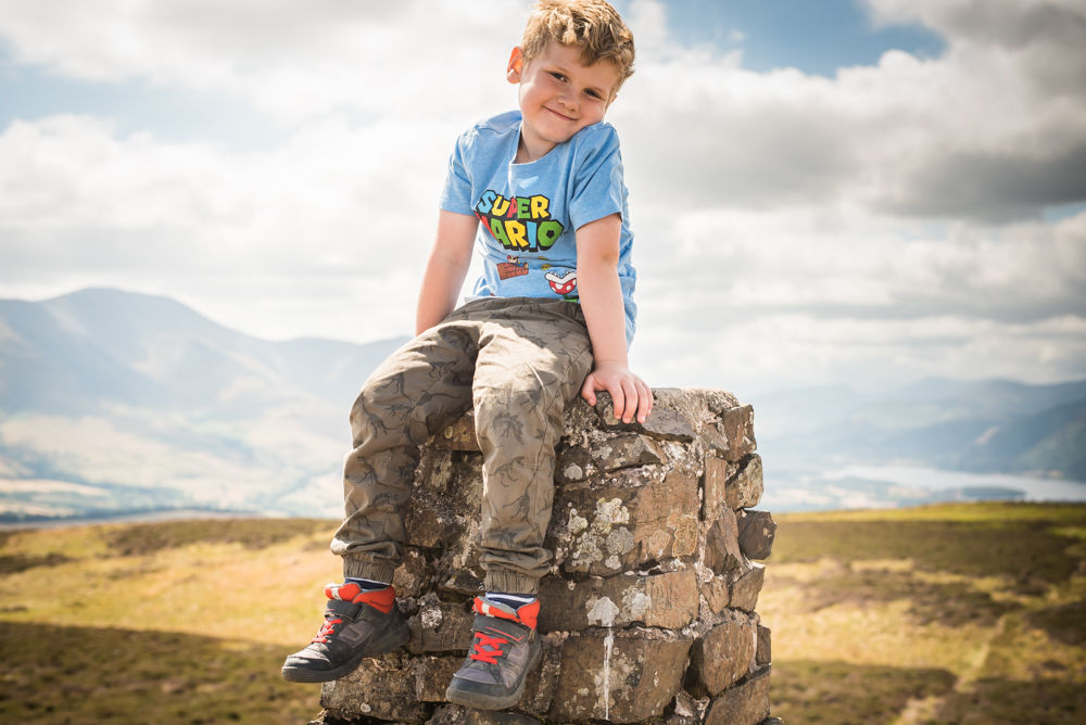 Stan sitting on cairn, Binsey, Lake District photographers