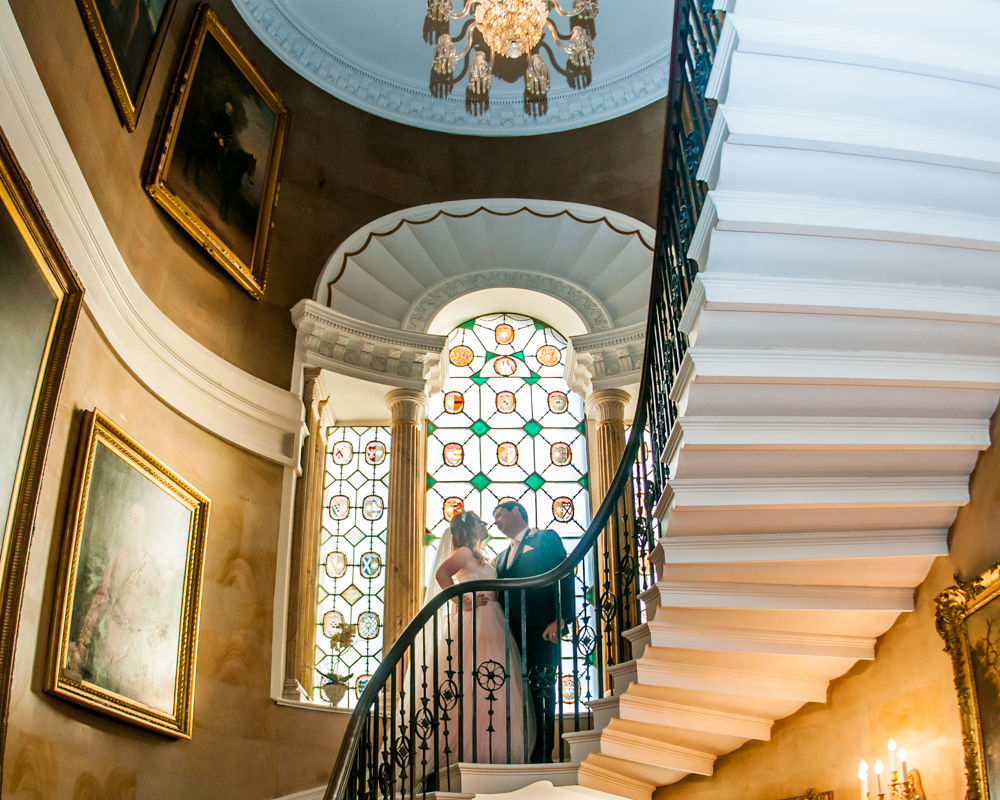 Bride and groom on stairs in castle, Ripley Castle weddings, Yorkshire wedding photographers