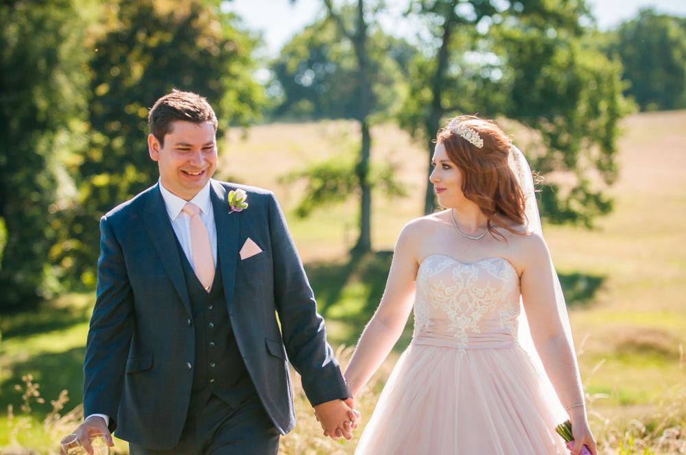 Bride and groom walking in castle grounds, Ripley Castle weddings, Yorkshire wedding photographers