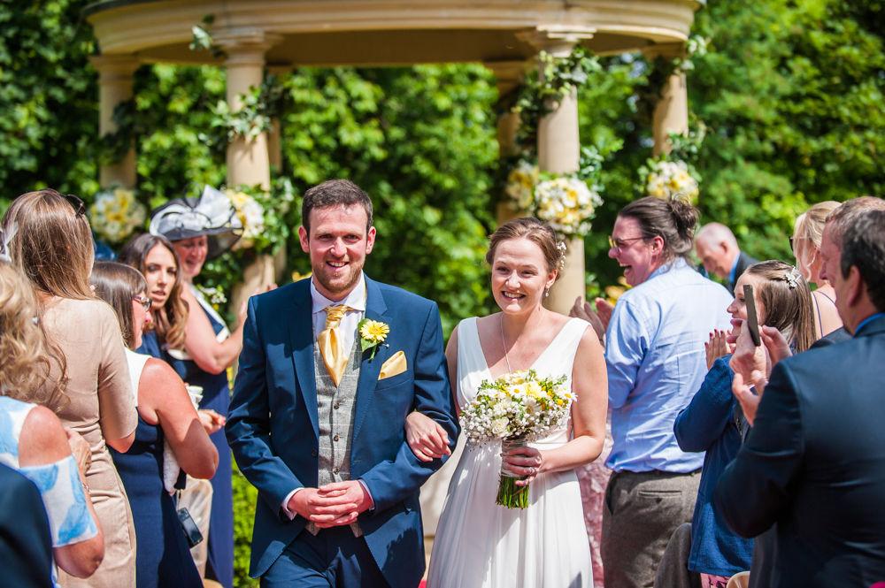 Bride and groom walking back down aisle, outdoor ceremony, Ringwood Hall weddings, Sheffield wedding photographer
