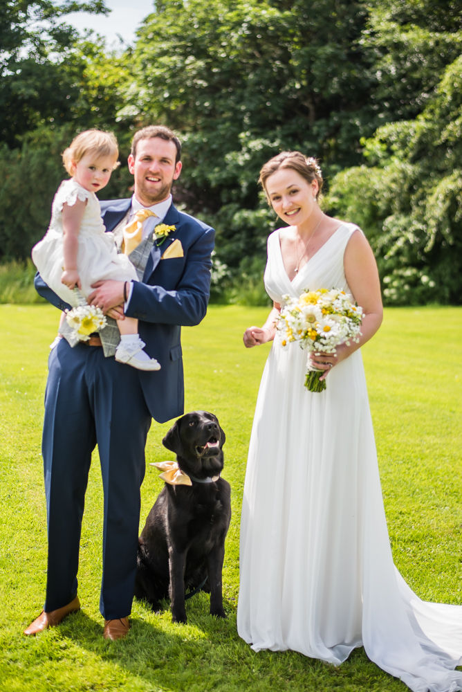 Bride and groom with daughter and dog posing, Ringwood Hall weddings, Sheffield wedding photographer