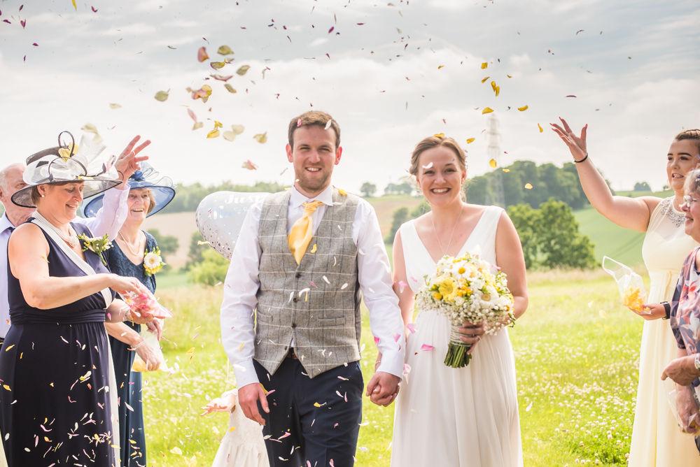 Bride and groom walking through confetti, Ringwood Hall weddings, Sheffield wedding photographer