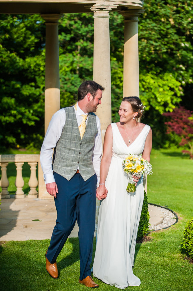 Bride and groom walking past pagoda, Ringwood Hall weddings, Sheffield wedding photographer