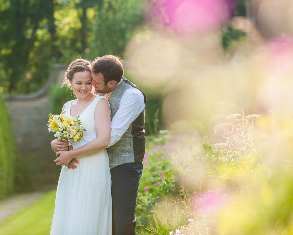 Bride and groom posing in hotel grounds, Ringwood Hall weddings, Sheffield wedding photographer