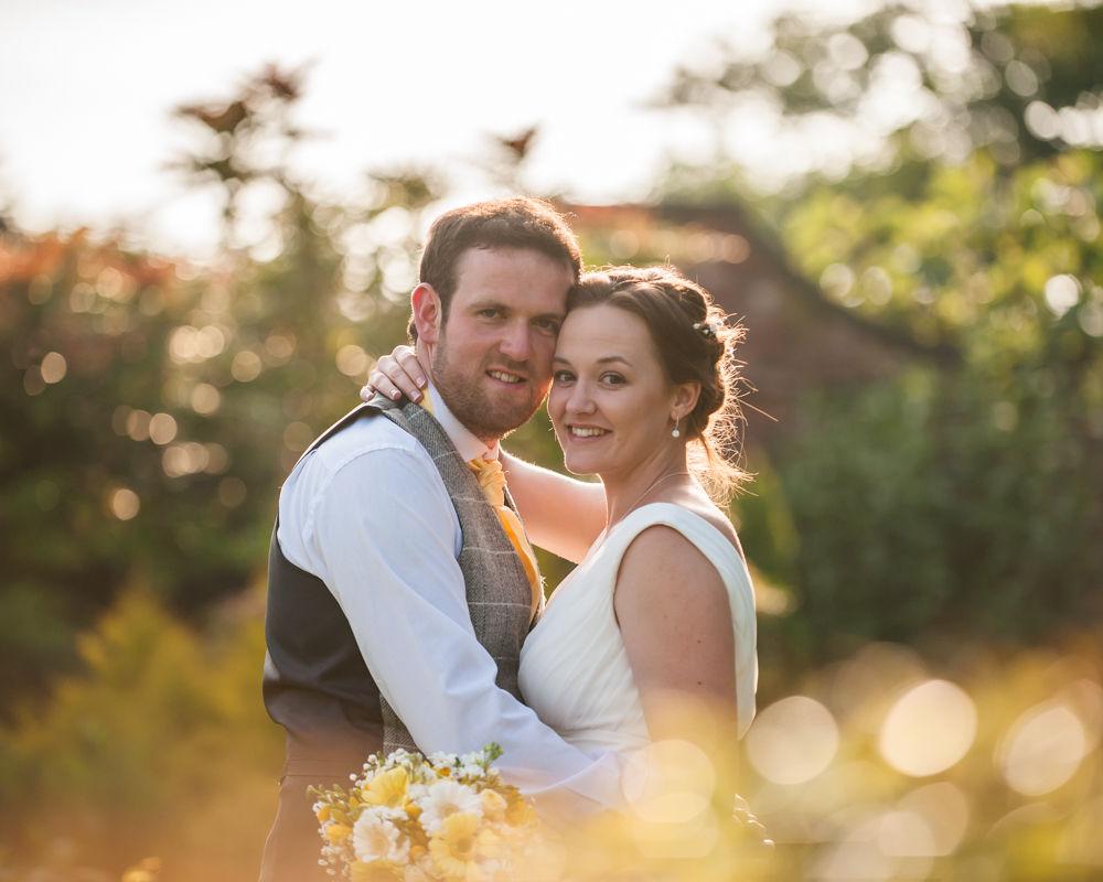 Bride and groom posing in rose garden, Ringwood Hall weddings, Sheffield wedding photographer