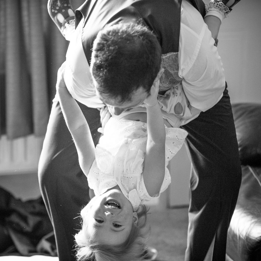 Groom tipping his daughter down, Ringwood Hall weddings, Sheffield wedding photographer